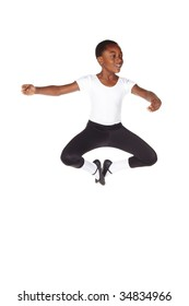 Young African ballet boy on white background and floor showing various ballet steps and positions. Not Isolated