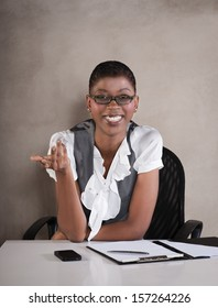 """Young african business executive smiling """"office girl"""""""