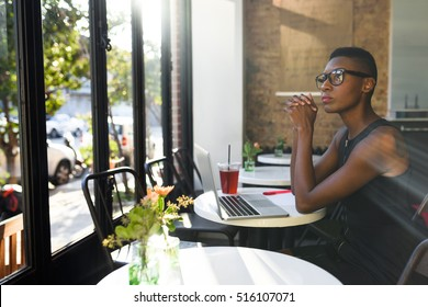 Young african business woman working at the cafe