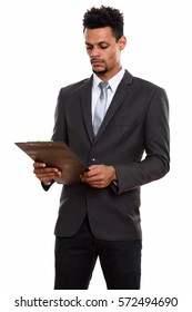 Young African businessman reading on clipboard