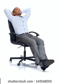 Young African Businessman Relaxing On Chair Over White Background