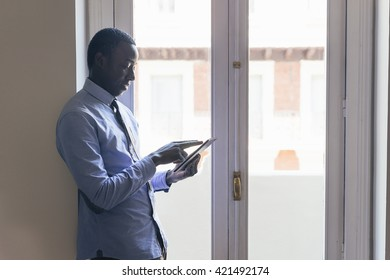 Young African Businessman Working at the office.