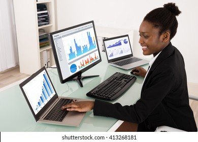Young African Businesswoman Analyzing Graph On Computer