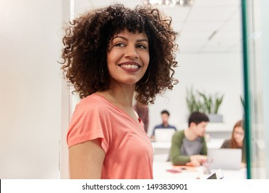 Young african businesswoman as apprentice or intern in coworking office