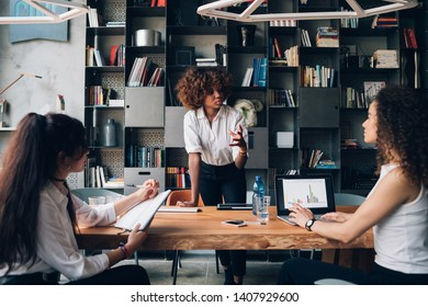young african businesswoman interacting with colleagues in coworking office and working on project – emancipation, dedication, resourceful