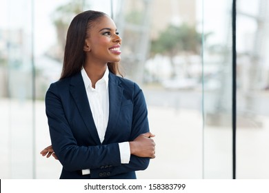 young african businesswoman looking out the window