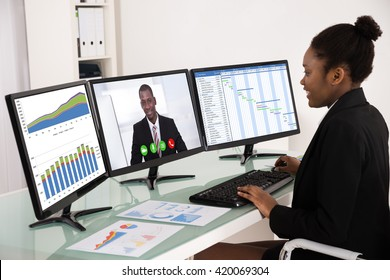 Young African Businesswoman Working With Multiple Computer Screen