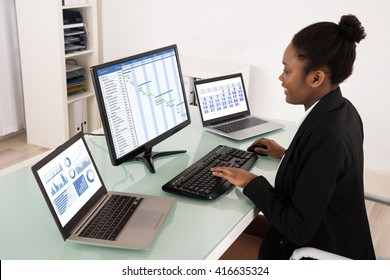 Young African Businesswoman Working On Gantt Chart In Office