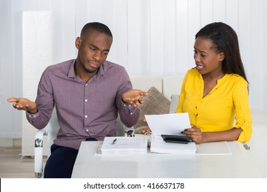 Young African Couple Arguing Over Bill At Home