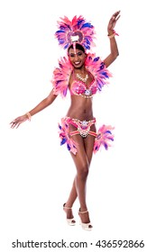 Young african dancer poses in front of the white background.