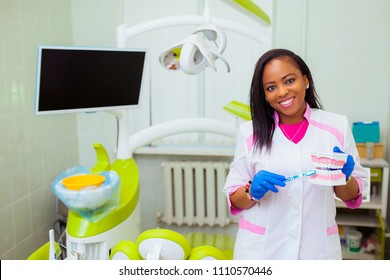 Young African doctor. Female dentistry student black girl dentist standing in a dental treatment room. medical equipment