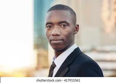 Young African entrepreneurial achiever looking confidently at camera