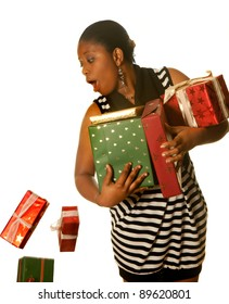 Young african girl dropping a few christmas presents