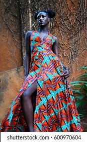 Young African girl in modern African print dress