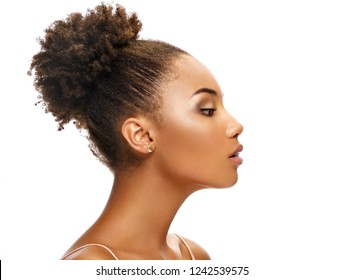 Young african girl in profile on white background. Youth and skin care concept