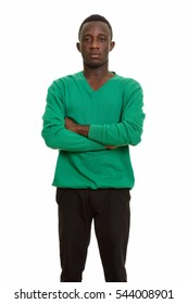 Young African man with arms crossed isolated against white background