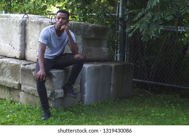 young african man around twenty outdoor sport portrait