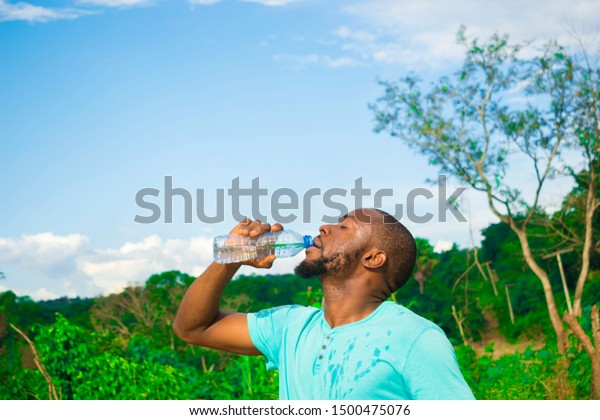 Young African Man Drinking Bottle Water Stock Photo Edit Now