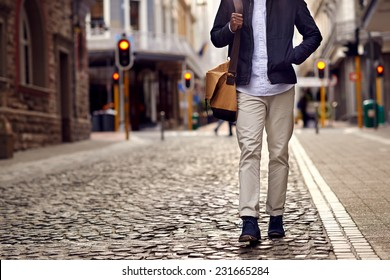 Young african man on vacation exploring european city cobblestone street