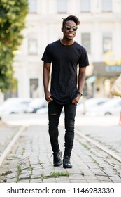 Young african man wearing black t-shirt in city street