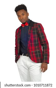 young african man wearing red plaid suit and bow tie on white background