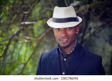 young african man white hat nature smiling portrait