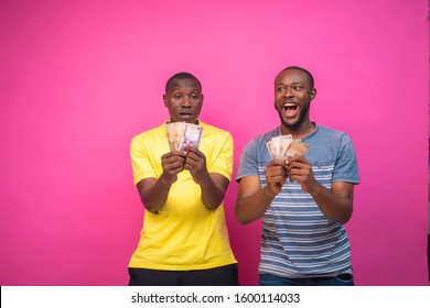Young African men happy and jubilating over some money they won