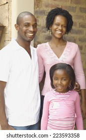 Young African parents with daughter smiling
