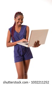 Young african student working with her laptop, isolated over a white background