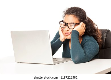 Young african tired woman sitting at her desk in front of laptop on white background