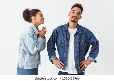 Young african woman apologizes to the her boyfriend over grey background