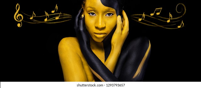 Young african woman with art fashion makeup. Amazing woman with black and yellow makeup and notes. Colorful paint on body.