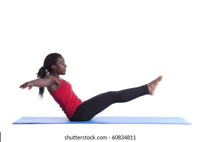 young african woman exercising with perfect body balance (isolated on white)