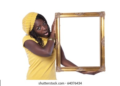 young african woman holding a picture frame with a funny expression (isolated on white)