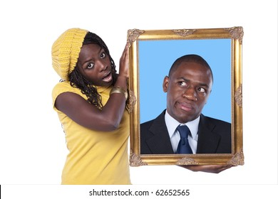 young african woman holding a portrait of a businessman with a funny expression (isolated on white)