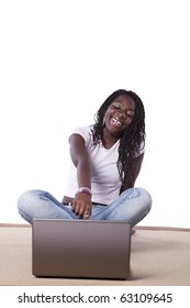 young african woman laying down on the carpet surfing the internet (isolated on white)