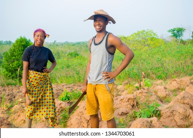 a young African woman and man feels happy after working on farm