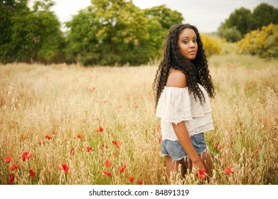 Young african woman picking poppys