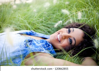 Young african woman relaxing in the park
