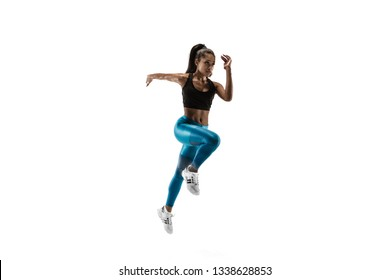 Young african woman running isolated on white studio background. One female runner or jogger. Silhouette of jogging athlete