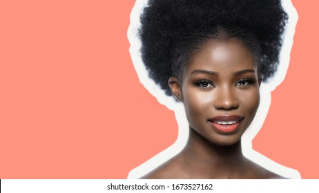 Young African Woman With White Healthy Teeth Smiles While Looking At Camera, Close Up Portret Of Dark Skinned Model Isolated On Pink Color Back, Copy Spase Is On The Left