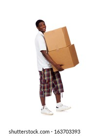 A young African-American male carrying moving boxes on a white background