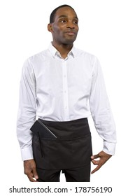 young African-American waiter wearing an apron on white background