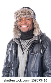 Young African-American wearing winter clothing but feeling cold in a white background
