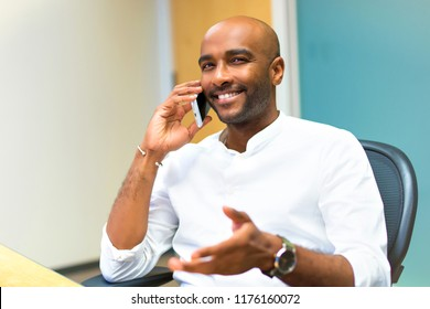 Young afro american businessman in the office using mobile phone