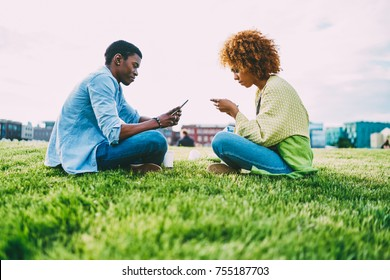 Young afro american friends ignoring real life communication blogging in networks using technologies, romantic couple having addiction to gadgets preferring online chatting to conversation