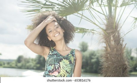 Young Afro American girl enjoying time on tropical beach.