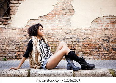 Young afro american girl in urban background
