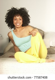 Young afro american woman a bed.