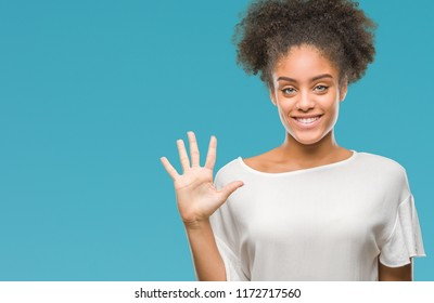 Young afro american woman over isolated background showing and pointing up with fingers number five while smiling confident and happy.